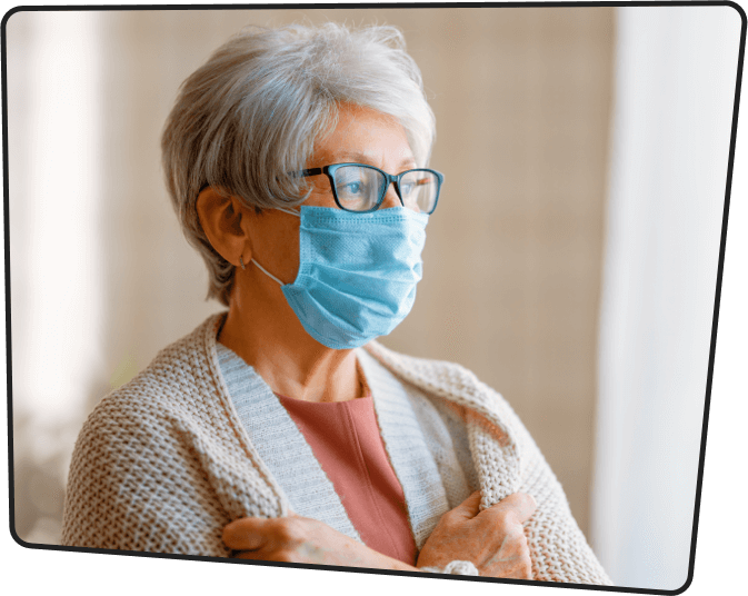 Senior lonely woman wearing a mask